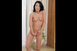 Sexy, dark-haired vixen disrobes down..